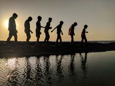 Free Group Of Children Walking Near Body Of Water Silhouette Photography Royalty Free Stock Photo - 112184685