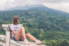 Free Woman In White Shirt And Blue Denim Short Shorts Sitting Royalty Free Stock Photos - 112301418