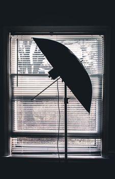 Free Silhouette Photo Of Studio Umbrella Near White Window Blinds Inside Room Stock Photo - 112301520