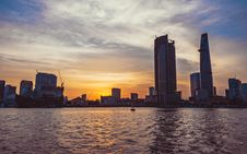Free High-rise Building In Front Of Body Of Water During Sunset Stock Photo - 112301590