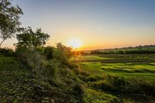 Free Green Grass And Trees At Golden Hour Royalty Free Stock Image - 112308796
