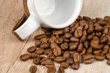 Free Coffee Beans Beside White And Brown Ceramic Mug Stock Image - 112363831