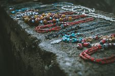 Free Close Up Photo Of Beaded Accessories On Gray Surface Stock Images - 112363864