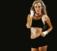 Free Woman Wearing Black Sports Bra And Shorts With Black Background Royalty Free Stock Photo - 112363875