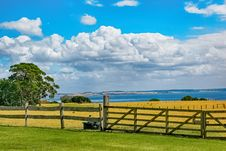 Free Brown Wooden Fence Across Crop Field Near Body Of Water Stock Photos - 112363913