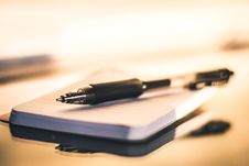 Free Black Point Pen On White Paper Royalty Free Stock Images - 112454949