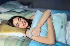 Free Photo Of A Woman Hugging A Blue Pillow Royalty Free Stock Photo - 112455015