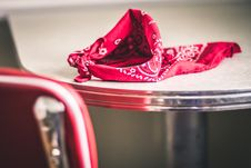 Free Red Paisley Handkerchief On Gray And White Table Stock Images - 112455224