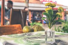 Free Yellow Flower Arrangement In Vase On Top Of Table Royalty Free Stock Photography - 112565117