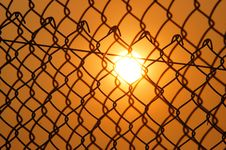 Free Sun Over The Cyclone Fence Royalty Free Stock Images - 112565239