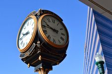 Free Close-up Photo Of Street Clock Near Tall Building Stock Image - 112669451