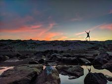 Free Person Jumping On Mountain Photo Stock Images - 112669484