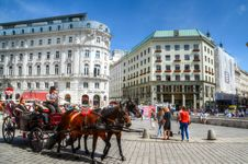Free Person On Carriage With Two Horses Near Concrete Building Stock Photo - 112669490