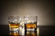 Free Two Clear Shot Glasses With Brandy Stock Photography - 112669572