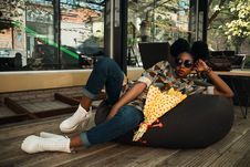 Free Woman Lying On Black Bean Bag Chair Near Cafe Royalty Free Stock Photos - 112669708