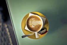 Free Coffee Latte On Saucer Beside Spoon Royalty Free Stock Images - 112738629