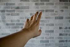 Free Person S Left Hand Near Gray Cinder Bricks Stock Photo - 112738640