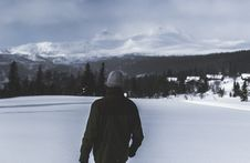Free Man Wearing Black Jacket Walking In The Snow Stock Photos - 112738643