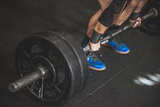 Free Close-up Of A Person S Lower Body Holding Barbell Stock Photo - 112738690