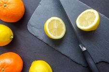 Free Two Orange And Three Lemons On Gray Surface Royalty Free Stock Photography - 112738757