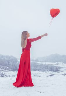 Free Woman In Red Floral Lace Long-sleeved Dress Standing With Red Heart Balloon Royalty Free Stock Photo - 112809375