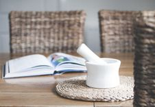 Free White Ceramic Mortar And Pestle Beside Book Royalty Free Stock Photography - 112809447