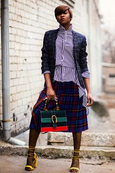 Free Woman In Blue And White Plaid Cardigan Holding Green And Red Handbag Royalty Free Stock Image - 112809466
