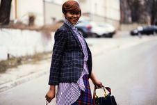 Free Photo Of Woman In Black And Gray Blazer Holding Bag Royalty Free Stock Image - 112809476