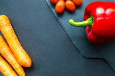 Free Three Red Carrots And Red Chilli Pepper Royalty Free Stock Image - 112809486