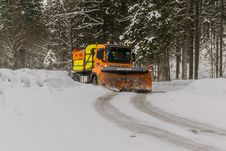 Free Yellow, Orange, And Black Truck Plowing Snow Stock Photo - 112809560