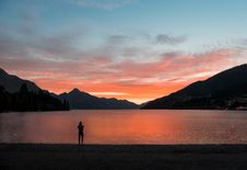 Free Silhouette Photo Of Person Standing Near Body Of Water Royalty Free Stock Image - 112809596