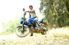 Free Man Riding Blue Sports Bike Stock Photography - 112809612