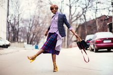 Free Woman In Purple Top And Plaid Skirt Near Car Stock Photo - 112878130