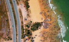 Free Aerial Photo Of Seashore Near Two Lanes Of Wide Road Stock Photography - 112878172