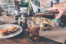 Free Photo Of Cola Pouring Into A Glass With Ice Cubes Stock Image - 112942601