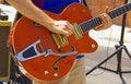 Free Man Playing Red Guitar Stock Photo - 1130050