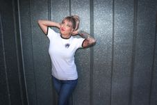 Free Tattooed Woman Wearing White Shirt And Denim Pants Stock Photo - 113035960