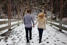 Free Man And Woman Walking On Snow Covered Road Royalty Free Stock Photos - 113036088