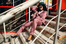 Free Woman Wearing Pink Suit Jacket And Pants Sitting On Staircase Royalty Free Stock Images - 113036089