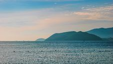 Free Scenic View Of Mountains Near The Ocean Stock Photography - 113036182