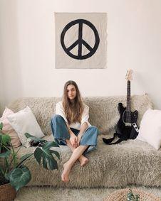 Free Woman Sitting In Grey Fur Sofa Stock Image - 113036231