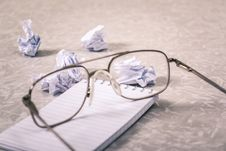 Free Close-Up Photography Of Eyeglasses Near Crumpled Papers Stock Photos - 113036303