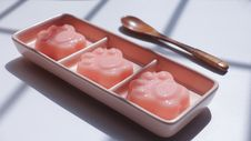 Free Paw Shape Jell-o On Pink Ceramic Container Near Brown Wooden Tablespoon Stock Photo - 113232170