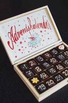 Free Chocolates On White Wooden Box Stock Photography - 113232212