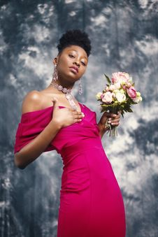 Free Woman In Pink Off-shoulder Dress Holding Pink And White Flower Bouquet Stock Image - 113232311