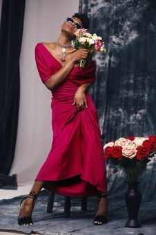 Free Woman In Red Dress Holding Flower Royalty Free Stock Image - 113232326