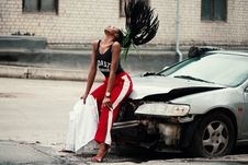 Free Woman In Black Tank Top Sitting In Front Of Car Stock Images - 113232384