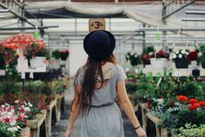 Free Woman Walking Between Display Of Flowers And Plants Stock Photo - 113295000