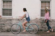Free Woman Riding On Teal Cruiser Bike Near Woman Wearing Pink Long-sleeved Shirt Royalty Free Stock Images - 113295019