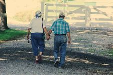 Free Old Couple Walking While Holding Hands Stock Photo - 113295080